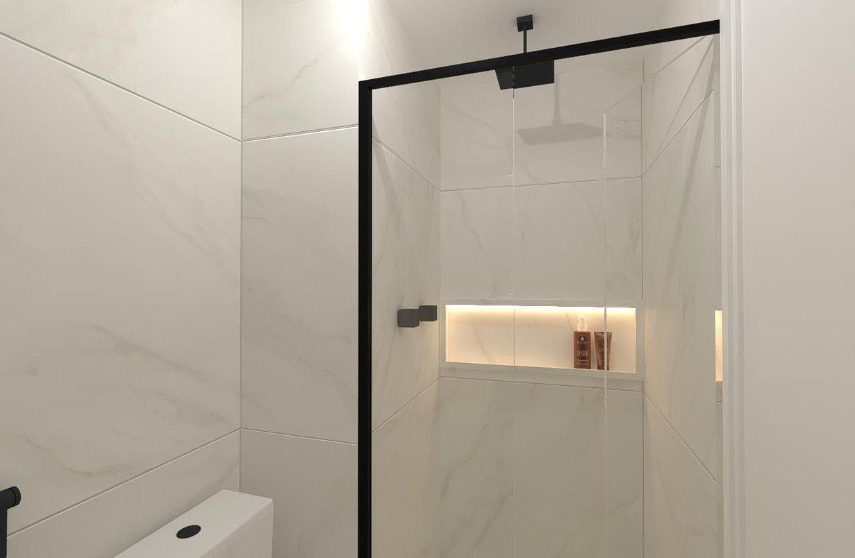 Banheiro Suíte revestido com a leveza do Bianco Covelano 90x90 natural e polido, aliado aos metais grafites (Docol metais) e pretos (espelho e esquadrias) que dão o toque moderno e despojado ao ambiente.