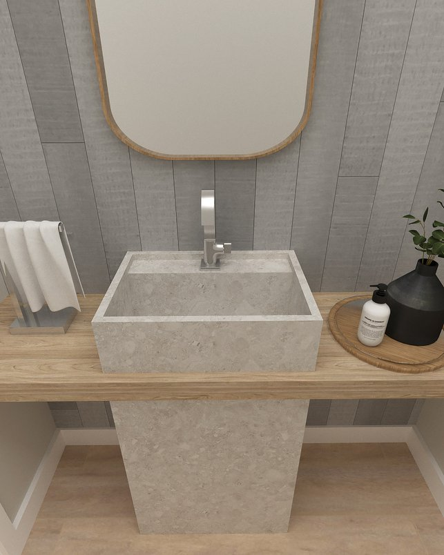 Projeto para lavabo em Florianópolis com cuba esculpida em Pietra Lombarda White e parede em Workshop Ash.