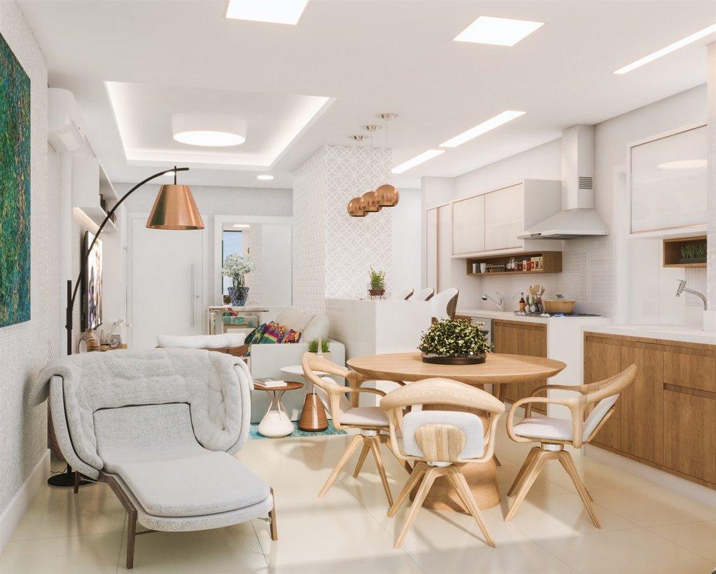 Na cozinha integrada a escolha de materiais segue a mesma linha do living, trazendo harmonia e leveza ao decor.