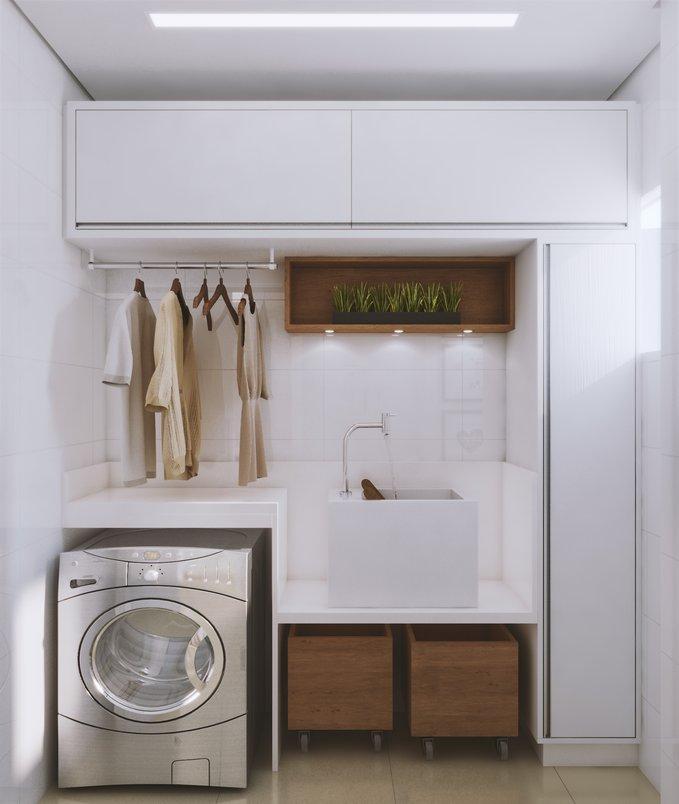 Uma solução muito prática e que economiza espaço é usar o tanque de louça de sobrepor. E para completar, caixas com rodízios para colocar as roupas sujas.